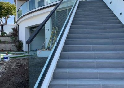Glass is an excellent material that can add both value and luxury to one's property. High-quality glass railings for patios, porches, decks, and balconies are one of the best options that homeowners can consider today. If you are planning to fabricate and install glass railings for your home or commercial property, LA Decks can help actualize those goals. We have a long-standing reputation of designing, fabricating, and installing top-notch glass railing systems for clients throughout the greater Los Angeles and Orange County area.  Understanding Glass Railings  When deciding on a railing system for one's balcony or deck, glass railings are regarded as the premier option. From a practical standpoint, these railings offer tons of benefits. They are exceptionally robust and that's why require minimal maintenance and can last for decades. In fact, glass railings are very safe options for raised platforms. They do not rot, deteriorate, or wear out. Homeowners can expect that these railing systems will remain reliable and safe throughout their entire lifetime. Most importantly, glass railings are designed to enable uninterrupted scenic perspectives, preserving surrounding views and scenery.  Why Do You Need Glass Railings?  Want to create the illusion of having more around the property? Glass railings can do that! These railing systems make the surrounding area appear even larger than it really is. This effect cannot be created with iron, chrome, or metal railing systems. If you and your loved ones enjoy an open and expansive atmosphere, glass railing systems will be the perfect solution. In addition, these railing systems allow light to shine through and can enhance the presence of sunlight. If installed indoors, they can even create an airy feel as well.  Homeowners are recommended to get glass railings because these systems can add a touch of modern sophistication. This comes in handy when one finally decides to sell his or her house. He or she can clinch significant profits during the resale process.  How LA Decks Can Help  At LA Decks, we plan and design glass railing systems according to our valued clients' lifestyle preferences. Our team considers the overall interior and exterior of the property to ensure that the glass railings complement the rest of the area. Since our inception, LA Decks has been offering a wide range of style options.  All of our glass railing services are performed by highly trained and professional installers. In addition to safely handling complex glass work, you can enjoy complete peace of mind that our company uses the sturdiest materials to get the job done!  Choose LA Decks for Custom Glass Railing Installation and Fabrication Services Today! LA Decks is a premier provider of glass railing systems for all types of properties. Our railing systems combine safety and luxury and are tailored to the unique design of your property. Our team will also take care of all the installation and delivery aspects of the project. We will complete the job according to your schedule.  LA Decks is a licensed, bonded, and insured glass railing contractor. We have been in business for over a decade and understand the requirements of single-family homes, townhouses, commercial establishments, and more. When you hire us, you can enjoy fine workmanship and competitively-priced glass railing products and services.  Have inquiries about our custom glass railing installation and fabrication services? Do not hesitate to call us at (323) 510-7228 or request a free estimate today!
